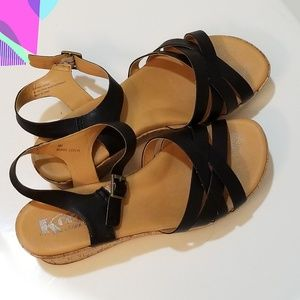Korks black leather wedges